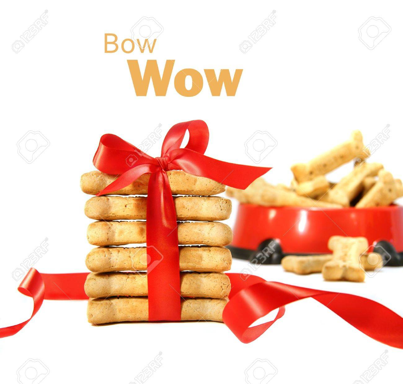 Dog biscuits wrapped with red bow on white background Stock Photo - 4006492