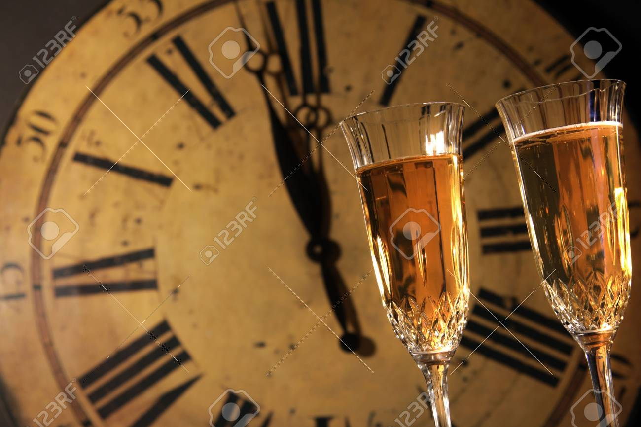 Celebrating New Years with glasses of champagne Stock Photo - 6122459