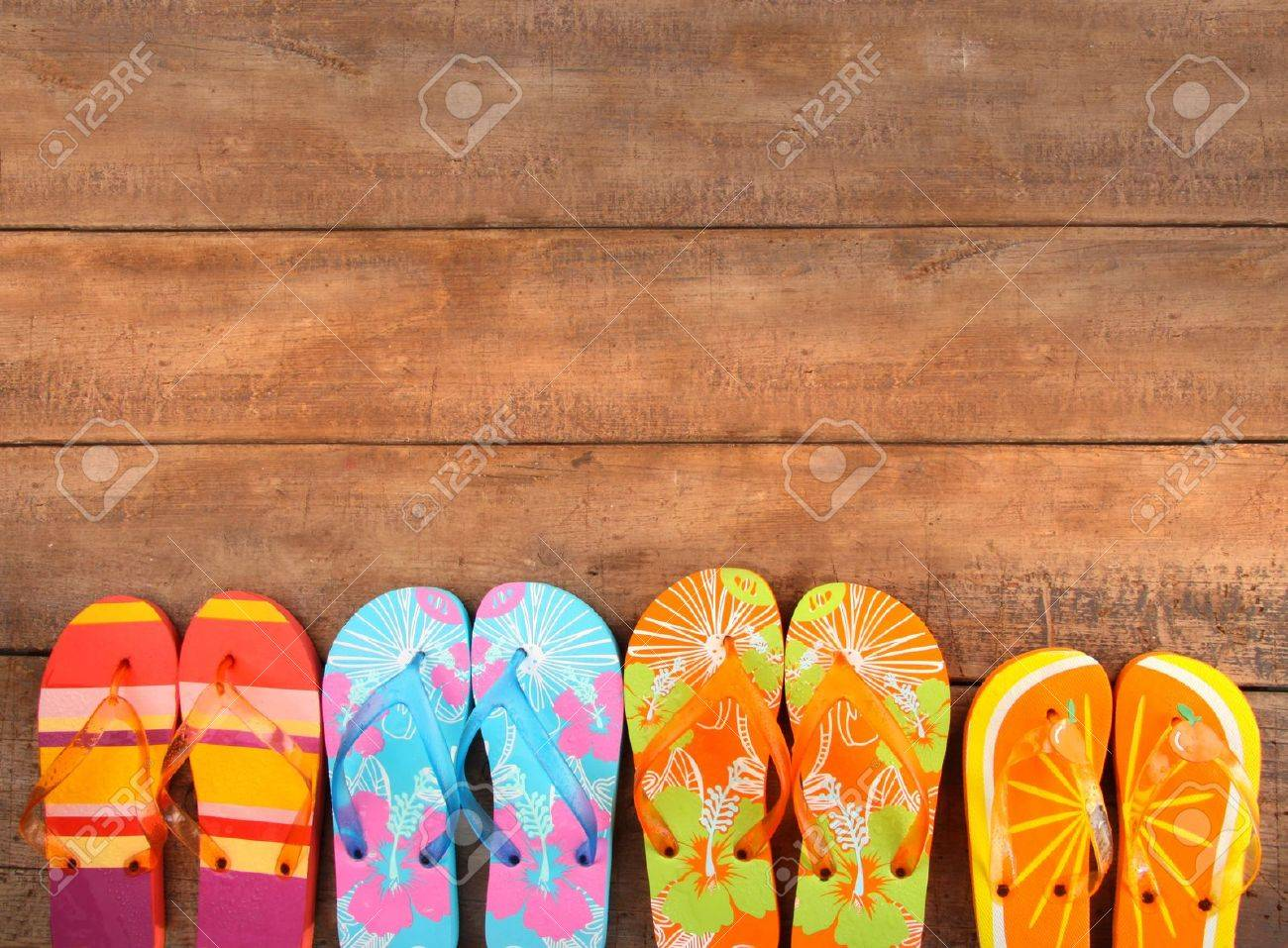 Brightly colored flip-flops on wood deck Stock Photo - 7227071