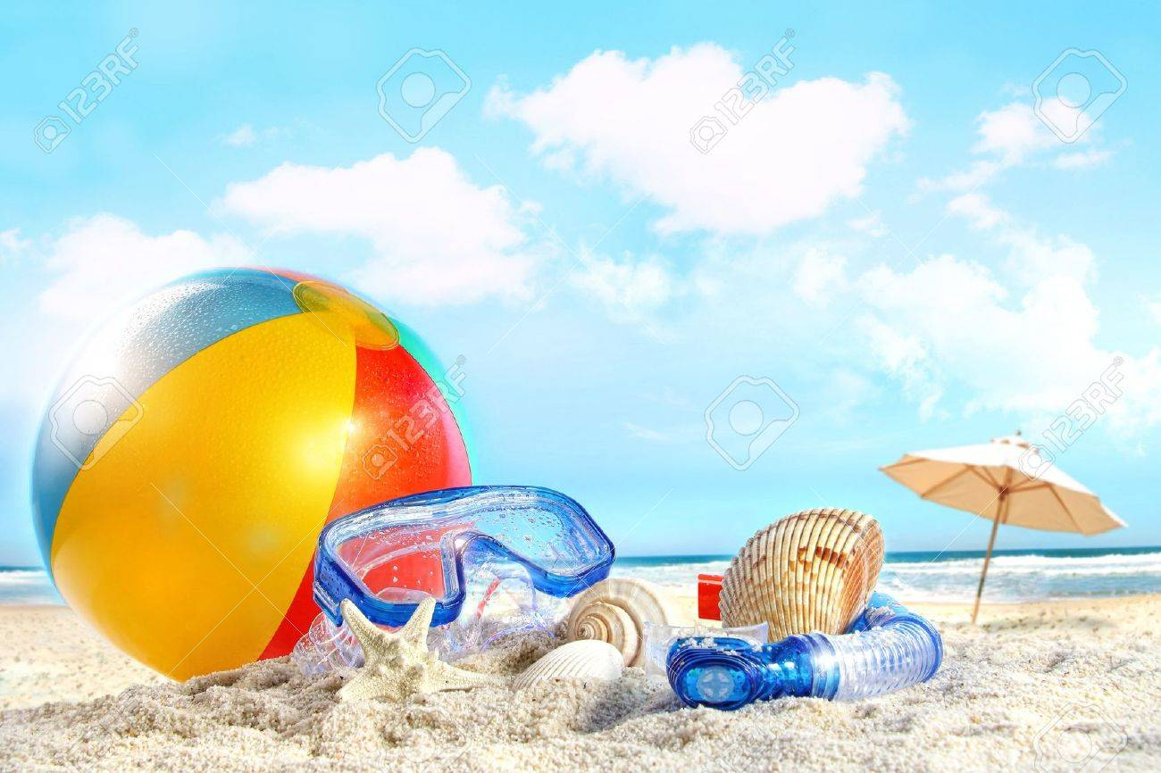 Fun day at the beach with goggles and beach ball - 9591765
