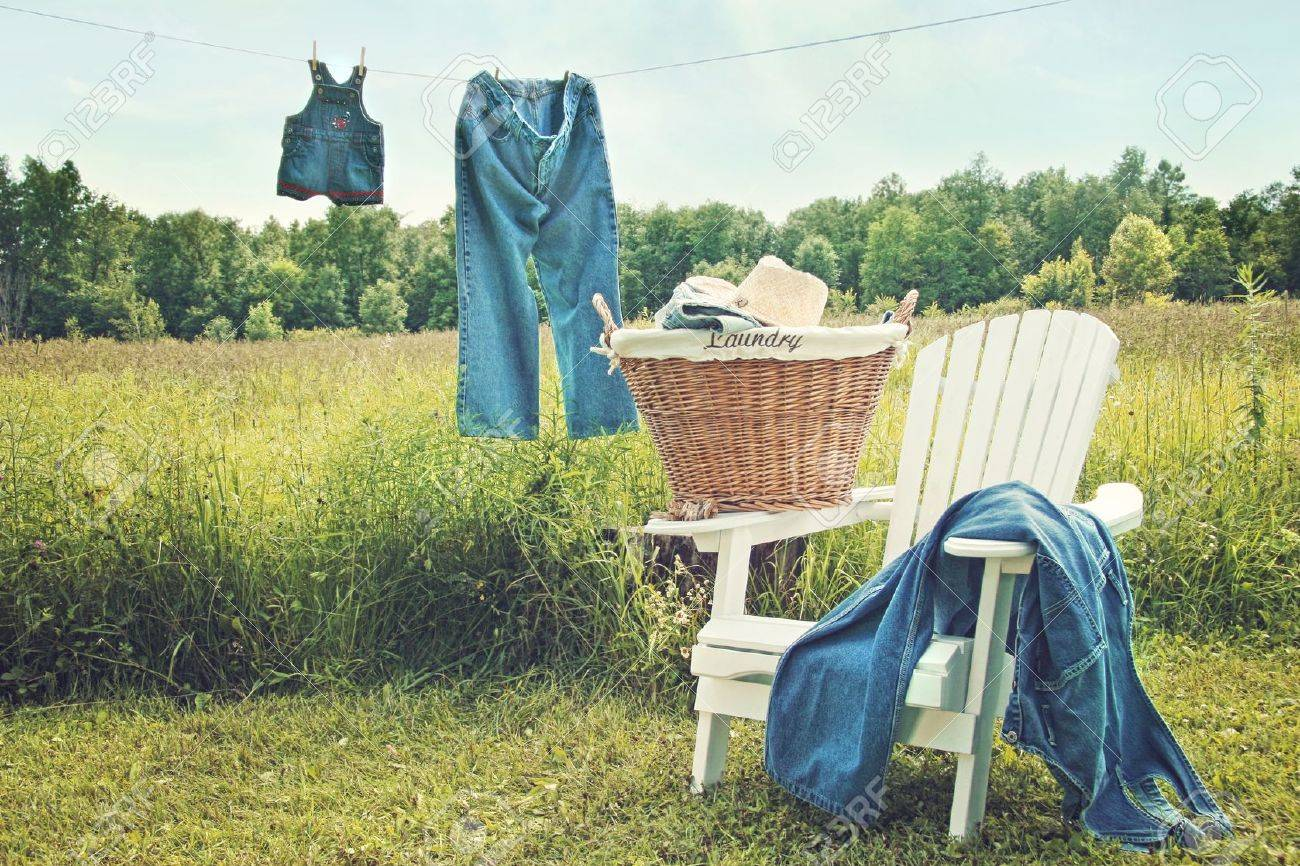 Jeans hanging on clothesline on a sunny summer afternoon Stock Photo - 9594383