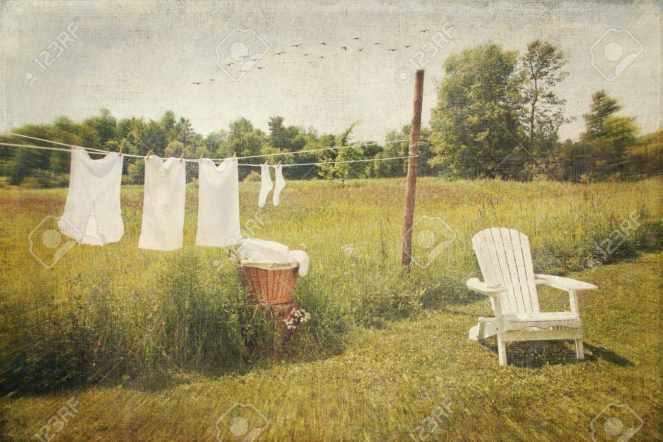 White Cotton Clothes Drying On A Wash Line With Vintage Feel Stock ...