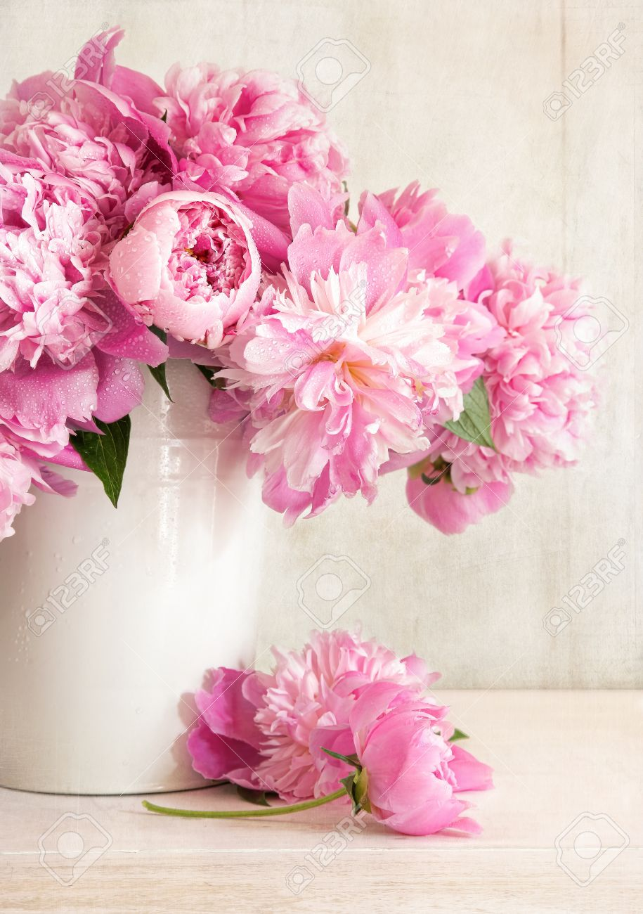 Pink peonies in vase on wood background Stock Photo - 13195050