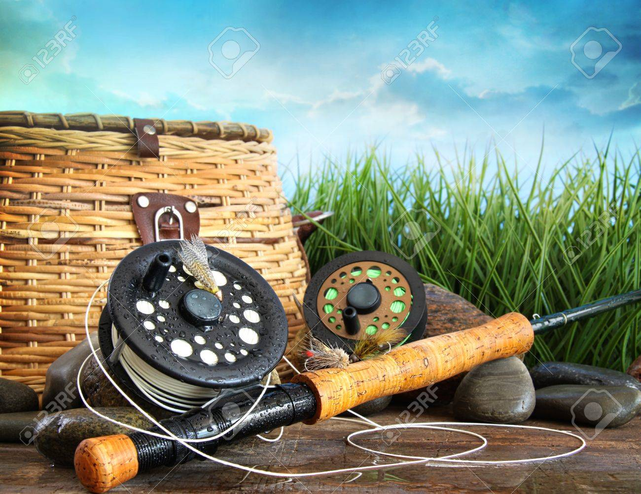 Closeup of fly fishing equipment and basket - 14878766