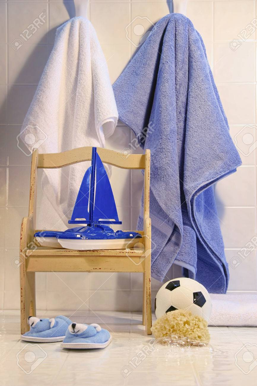 Bathroom floor towels - Toys With Chair And Towels On Bathroom Floor Stock Photo 43214203