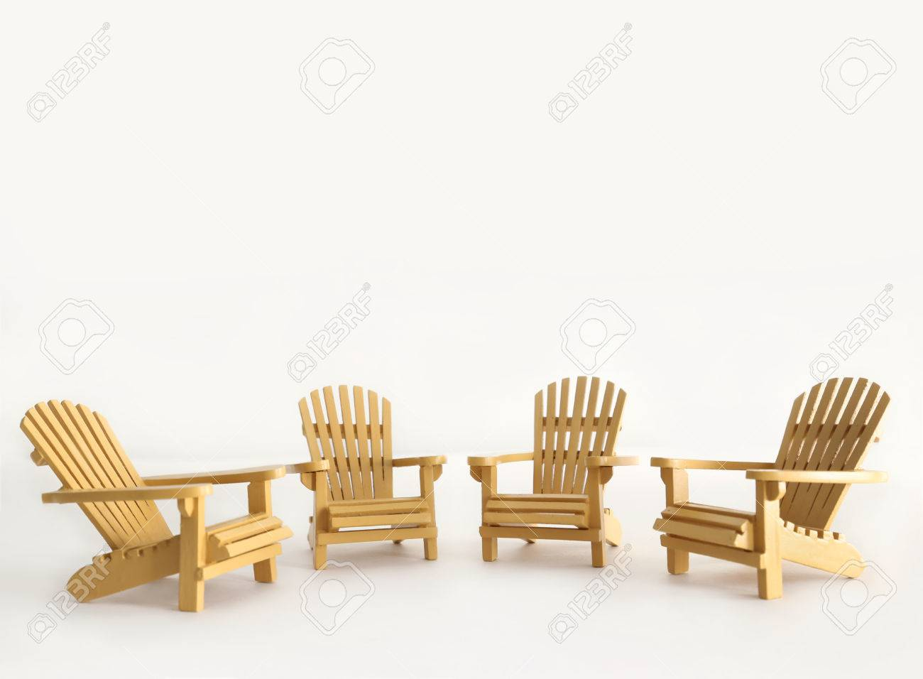 Four Miniature Adirondack Chairs On White Background Stock Photo   44432609