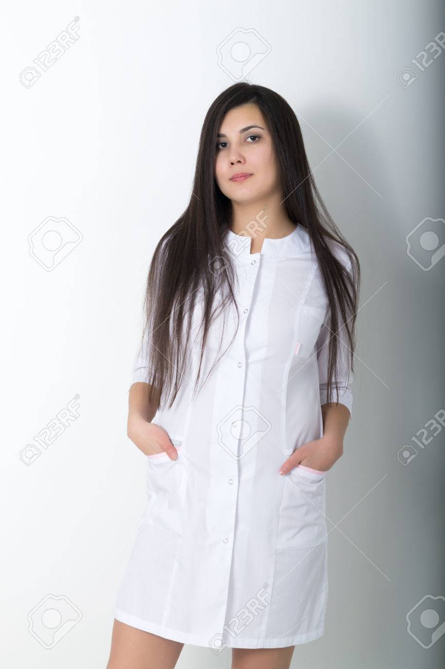 Beautiful Young Asian Female Doctor In Medical Gown Holding .. Stock ...