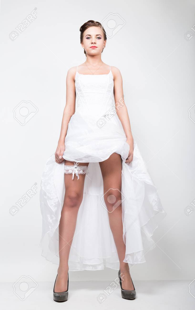 Full Length Bride In A Wedding Dress And Bridal Hairdo Lifted