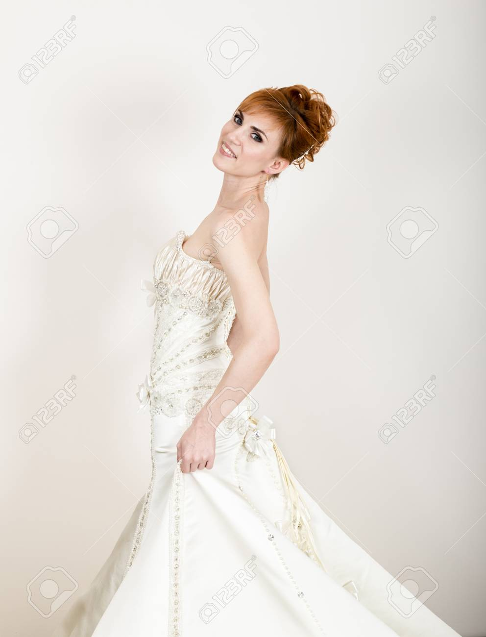 Wearing White To A Wedding.Beautiful Young Redhead Bride Wearing White Wedding Dress With