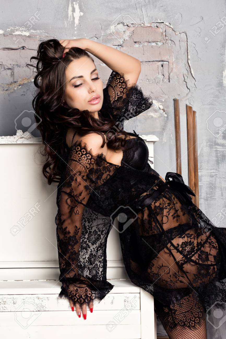 cbc5f626a22 fashion sexy young woman in black lacy lingerie and stockings posing on piano  Stock Photo -