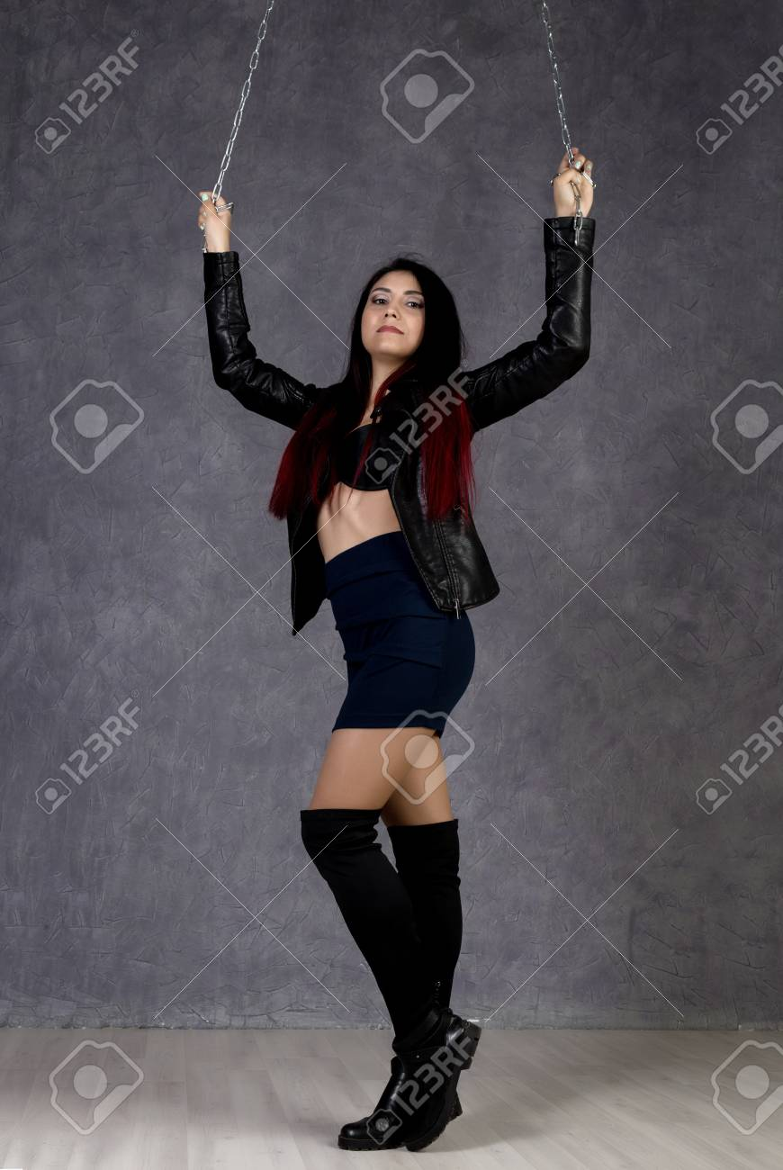 f4aedfc7029 sexy asian woman wearing leather jacket and black skirt holding..