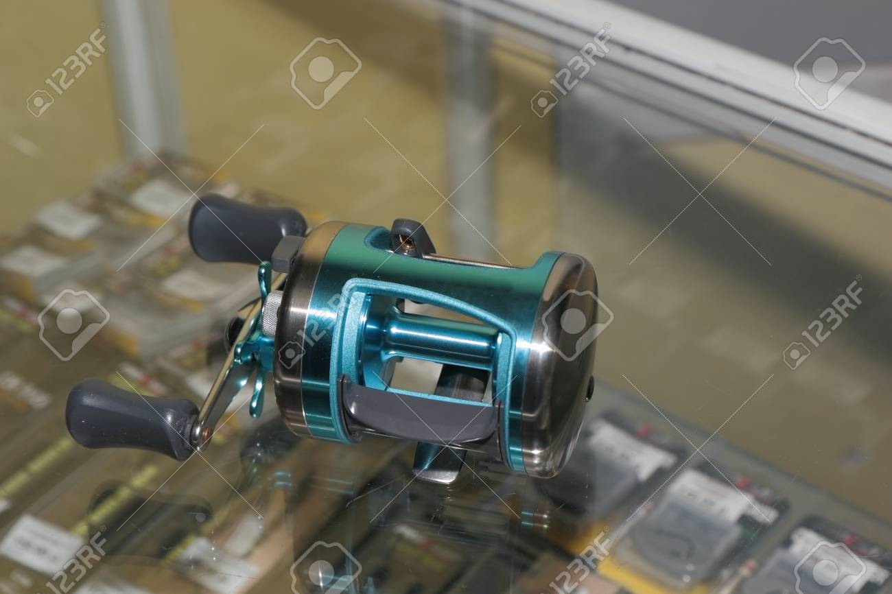 Attaches to the accessory rod for winding fishing line as belonging fisherman Stock Photo - 24253198