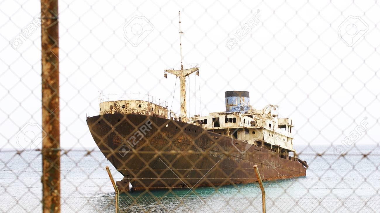 Abandoned boat Arrecife, Lanzarote, Canary Islands Stock Photo - 23700571