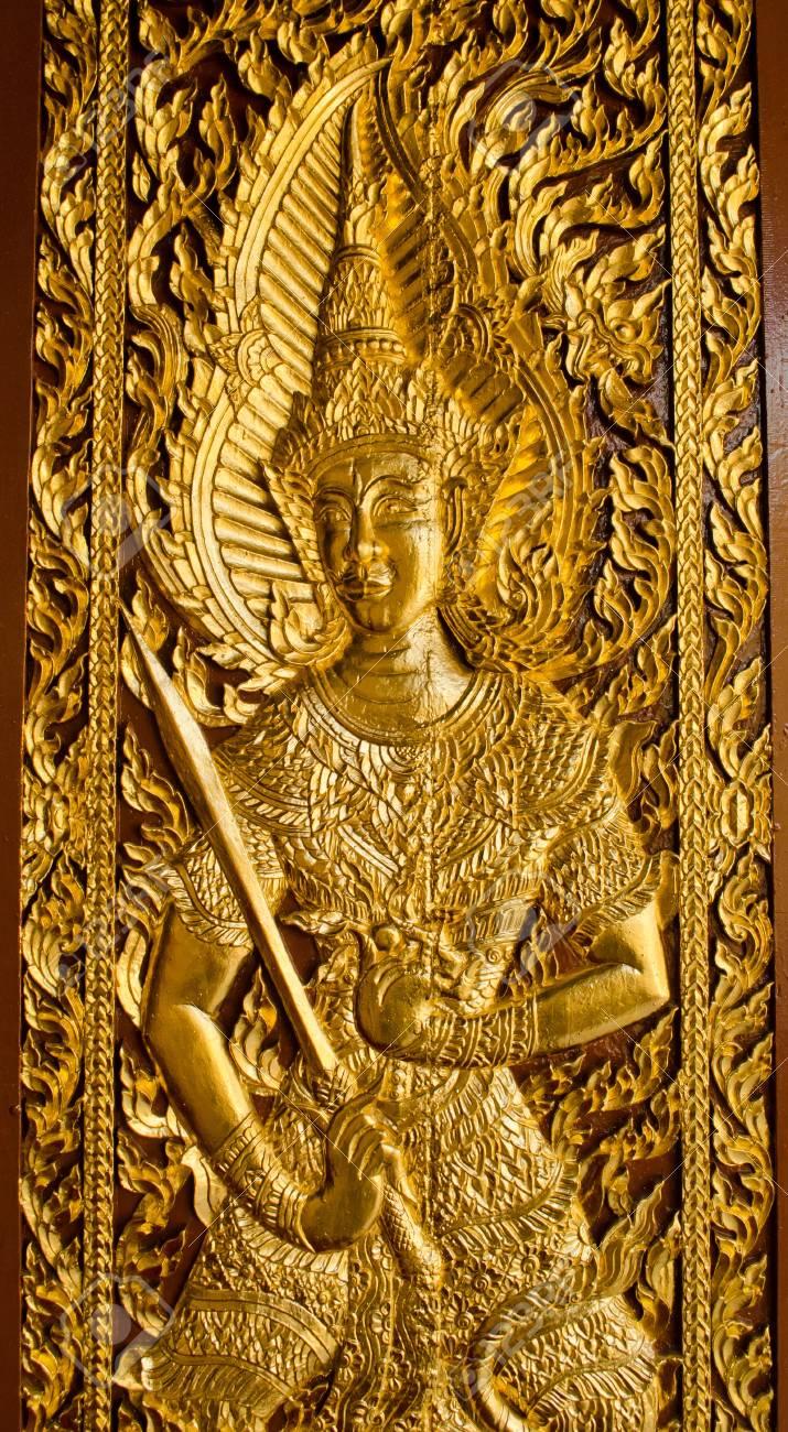 Thai Lanna style temple door in Wat Jedyod at Chaingmai , Thailand. Stock Photo - 12184152