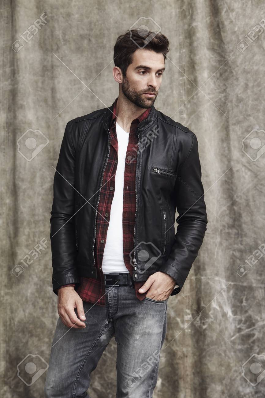 Leather Jacket Guy Looking Away In Studio Stock Photo Picture And