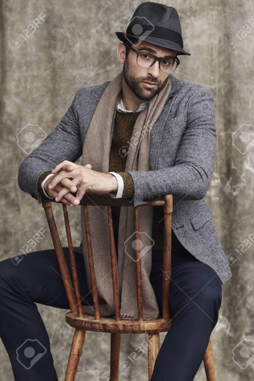 hipster in hat and scarf on chair portrait stock photo picture and
