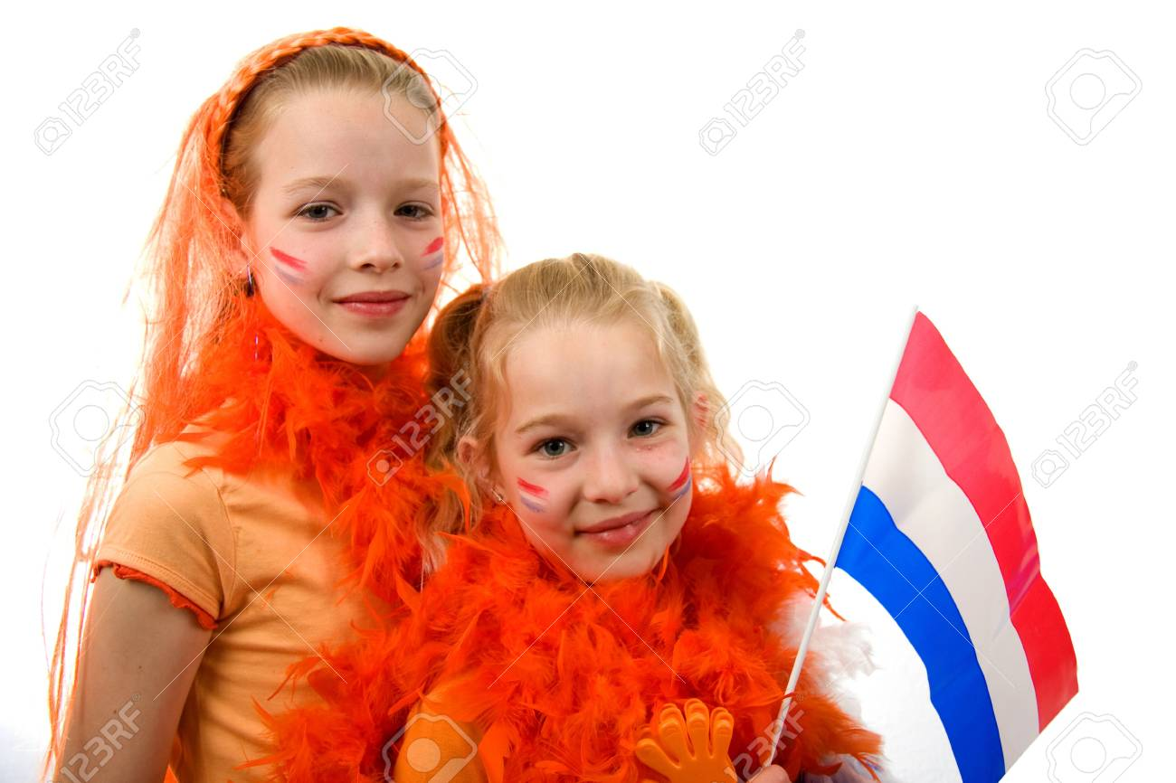 Young girls posing in orange with balloon and flag, isolated on white background Stock Photo - 5000092