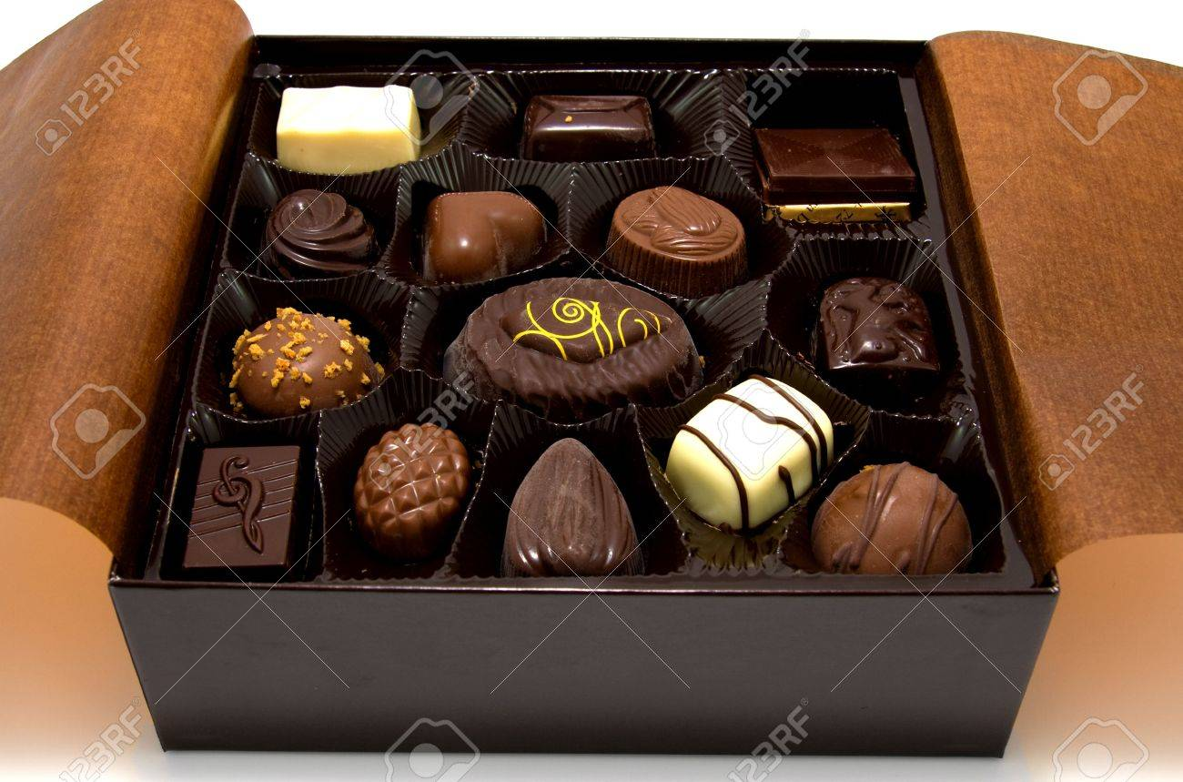 Chocolate Bonbons In Box, Closeup, Over White Background Stock ...