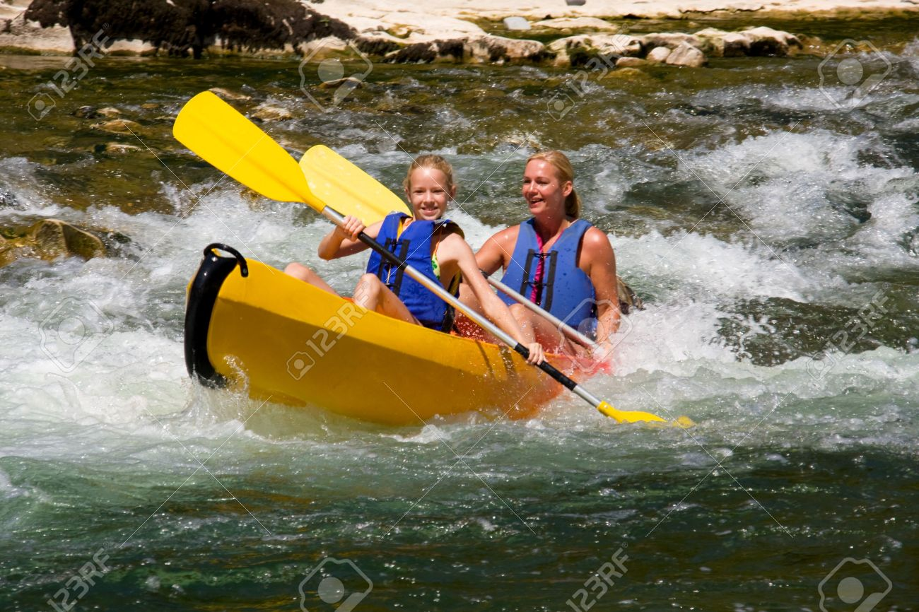 Two people in canoe enjoying holidays and nice weather Stock Photo - 5642298