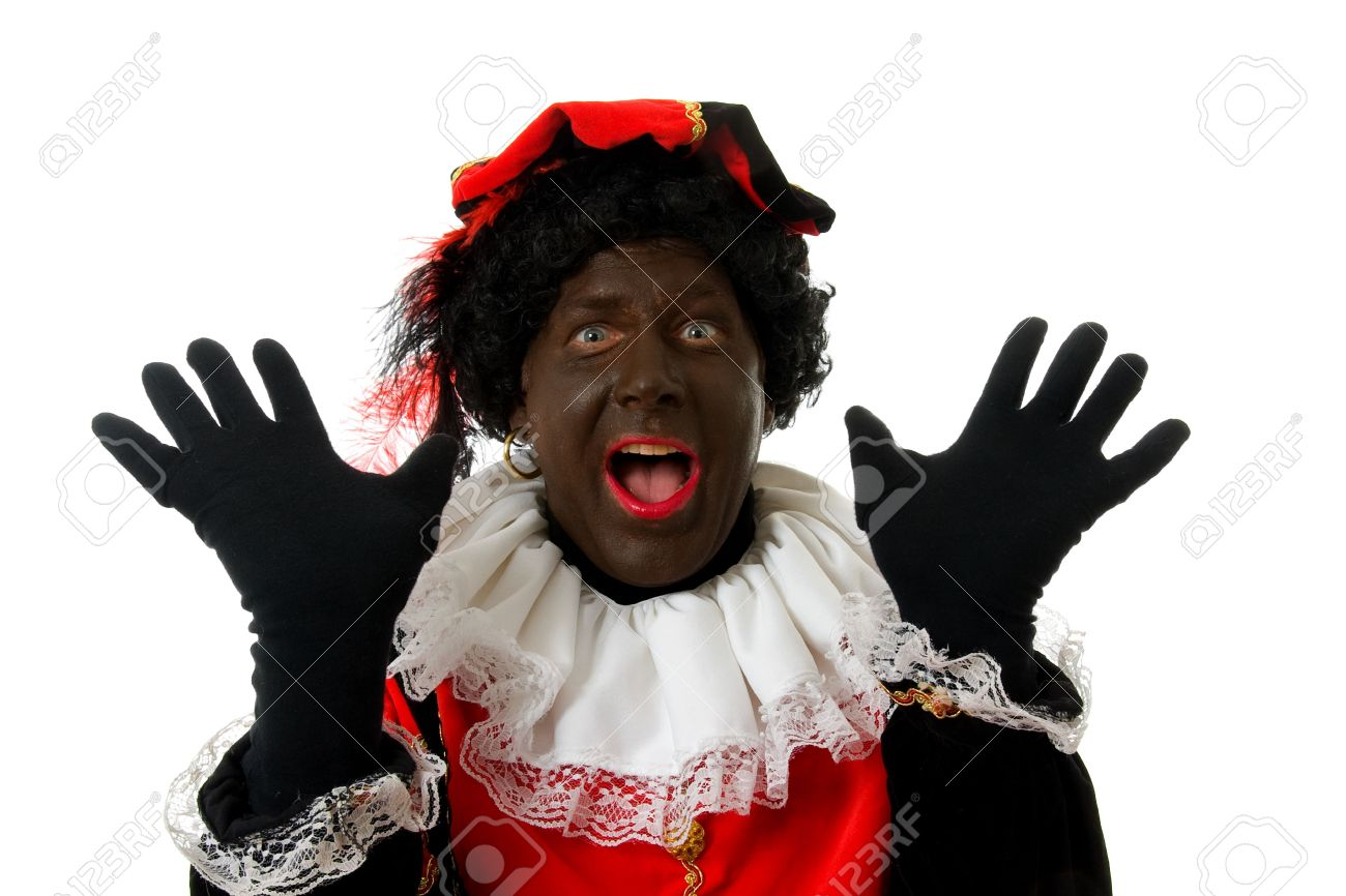 surprised Zwarte piet ( black pete) typical Dutch character part of a traditional event celebrating the birthday of  Sinterklaas in december over white background Stock Photo - 6037999