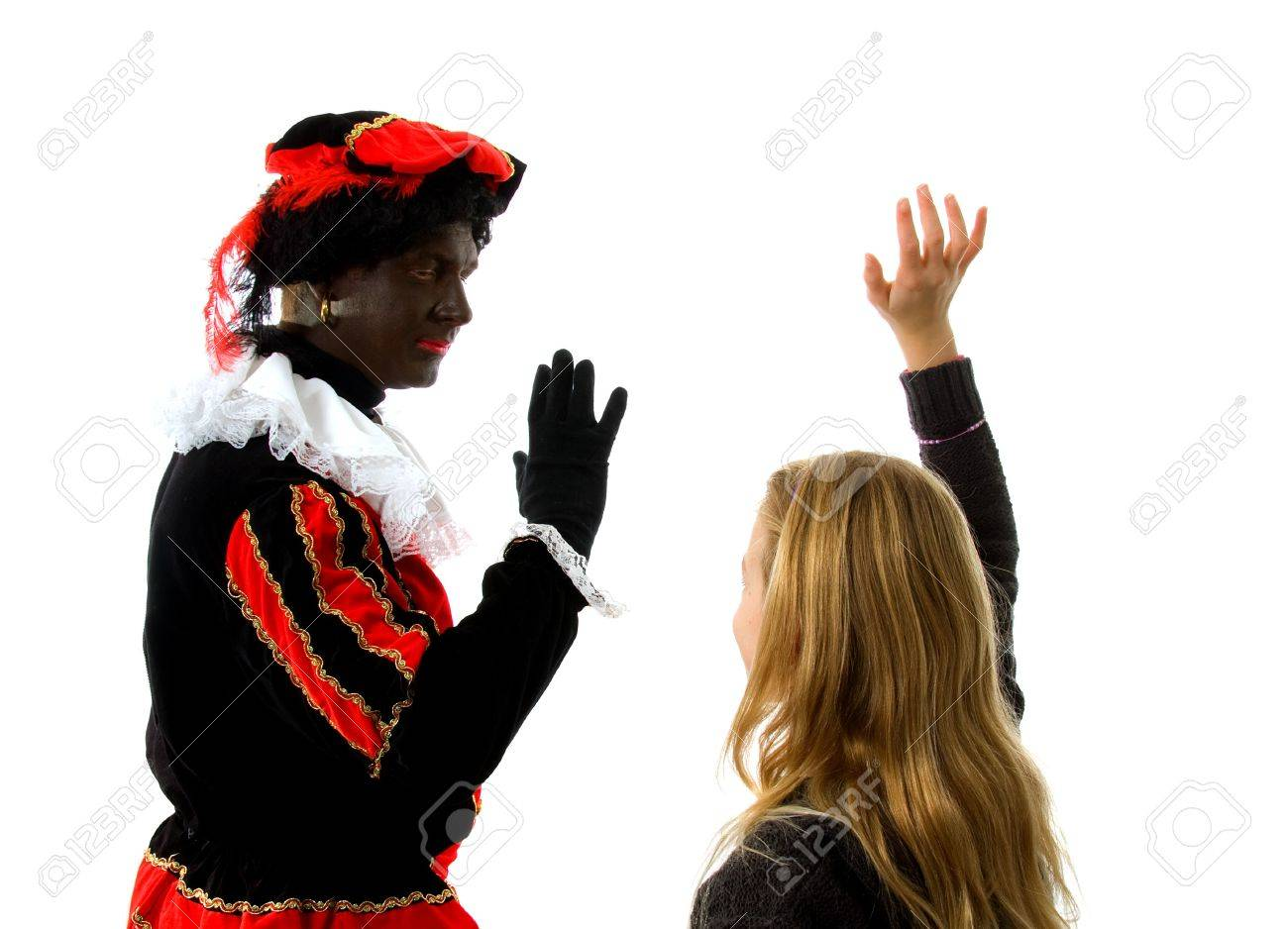 Blonde girl waves goodbye to Zwarte piet ( black pete) typical Dutch character part of a traditional event celebrating the birthday of  Sinterklaas in december over white background Stock Photo - 6037995