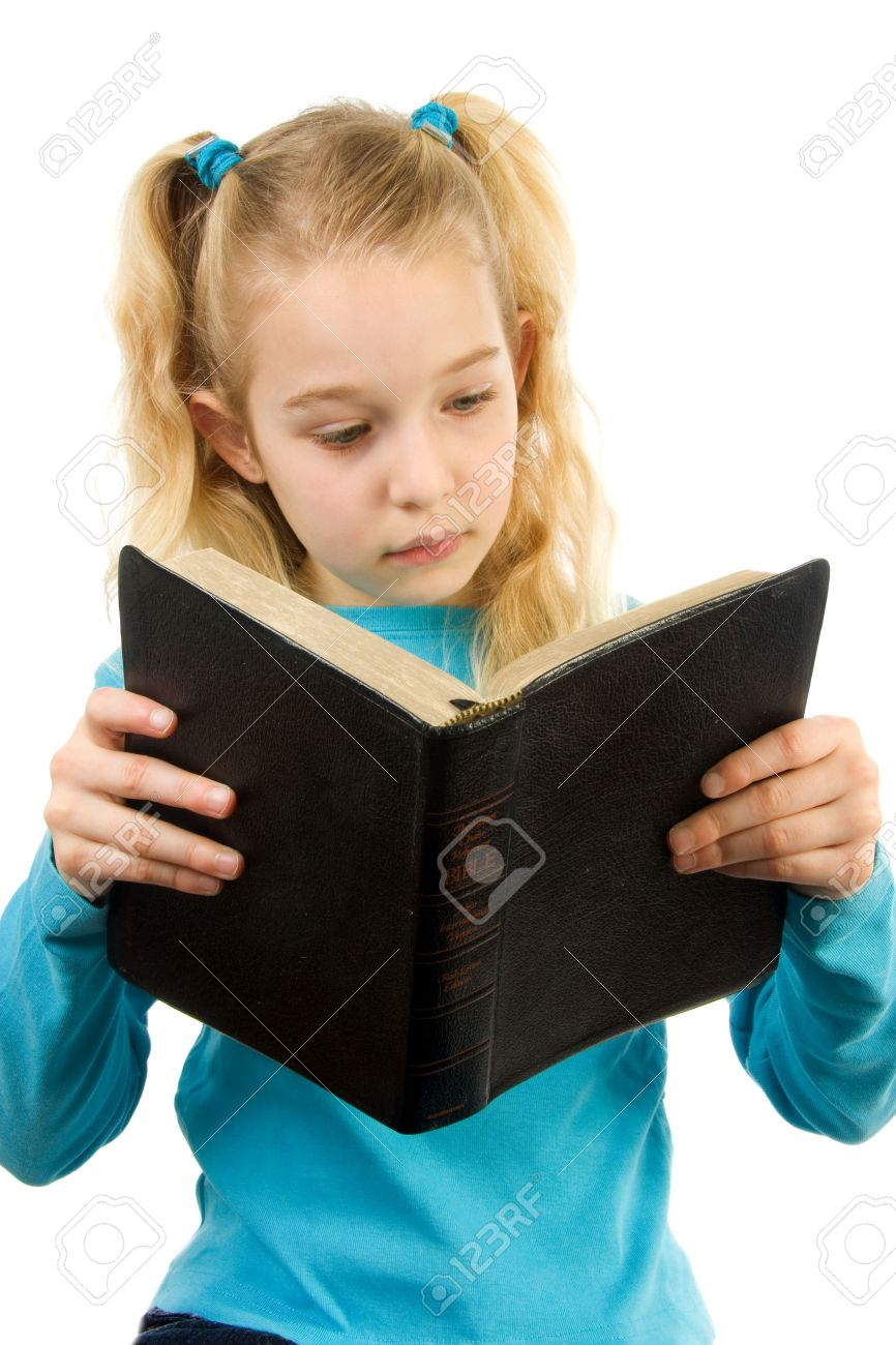 little blonde girl is reading the Holy Bible over white background Stock Photo - 6450782