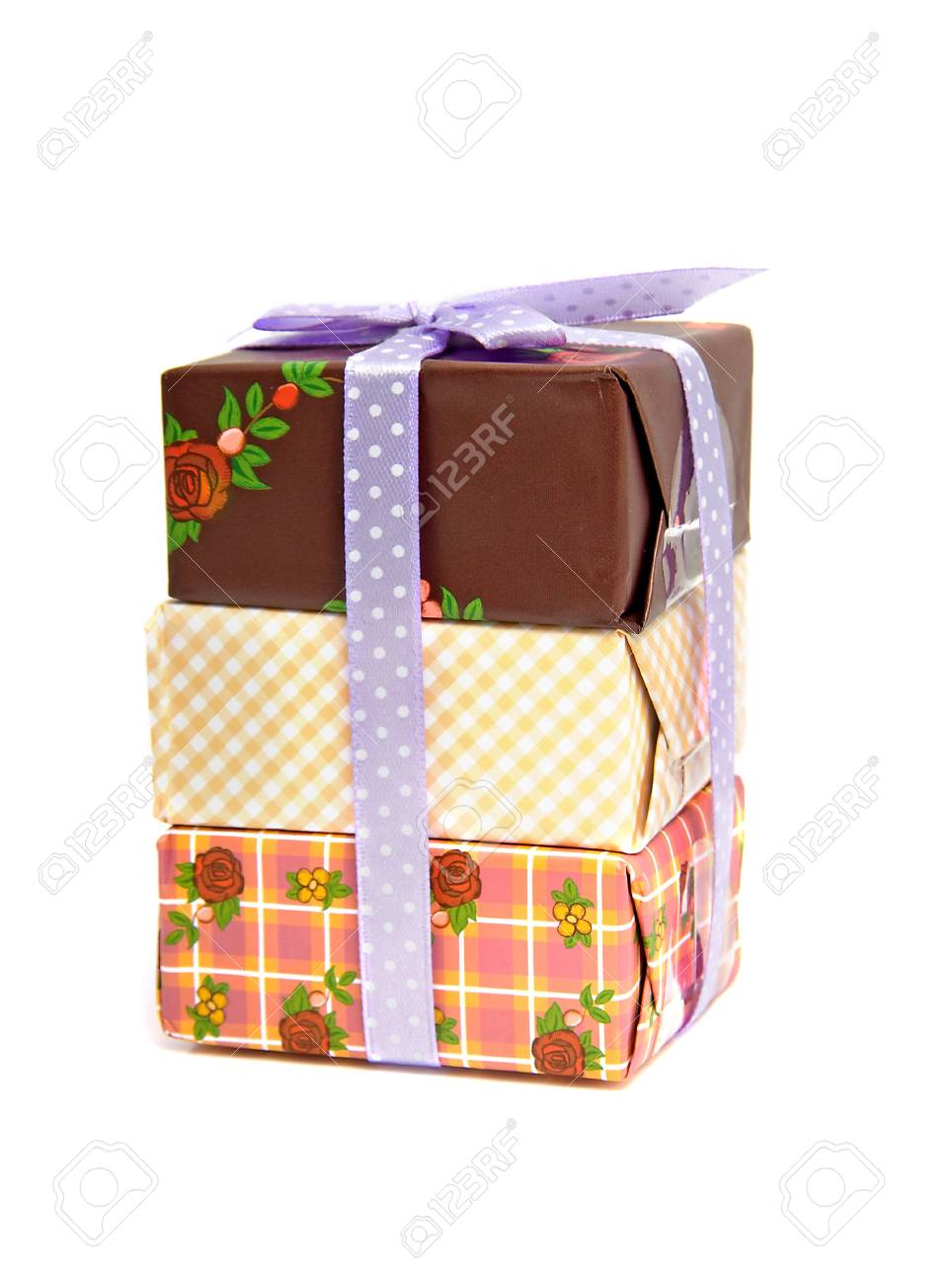 Pile of birthday presents with purple bow isolated on white background Stock Photo - 6551026