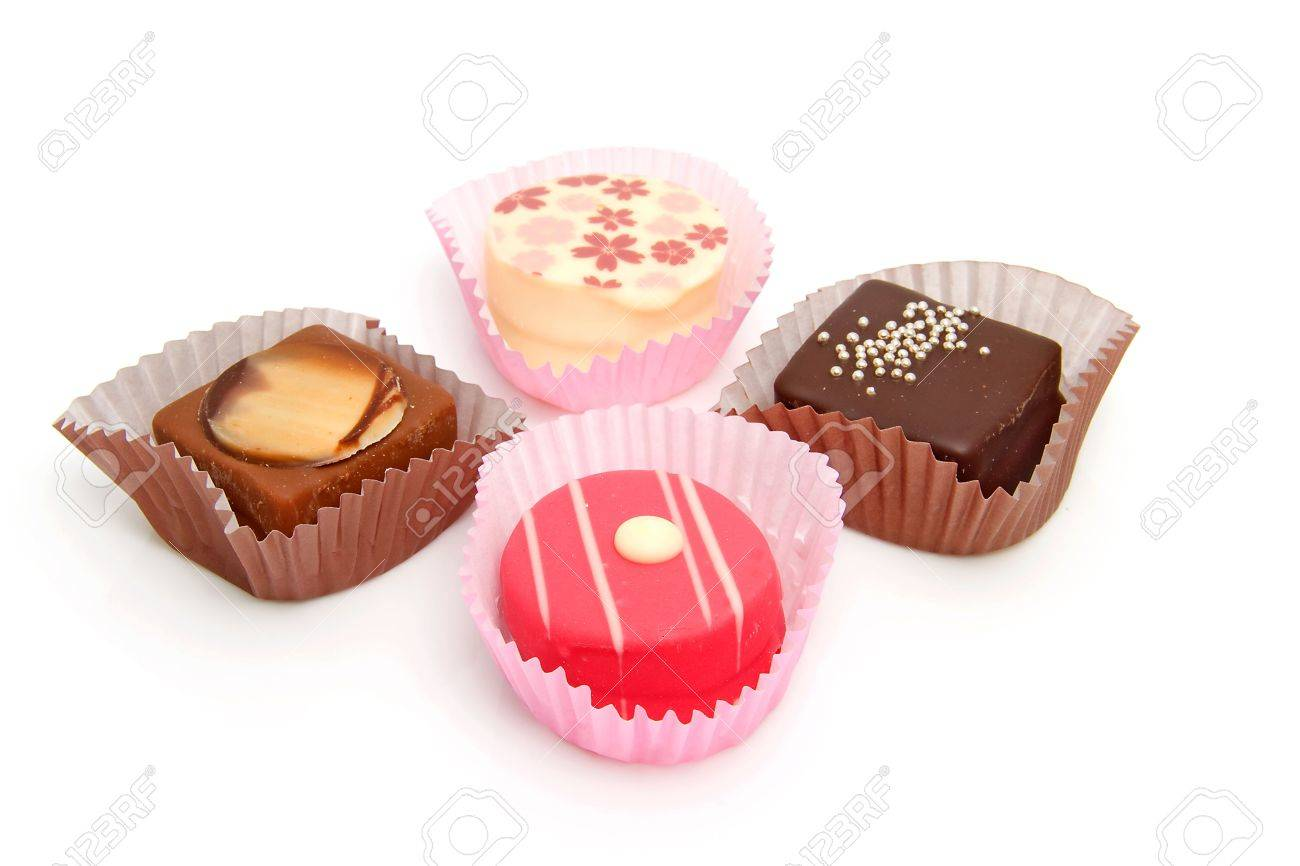 Delicious petit four, little cakes over white background Stock Photo - 6550996