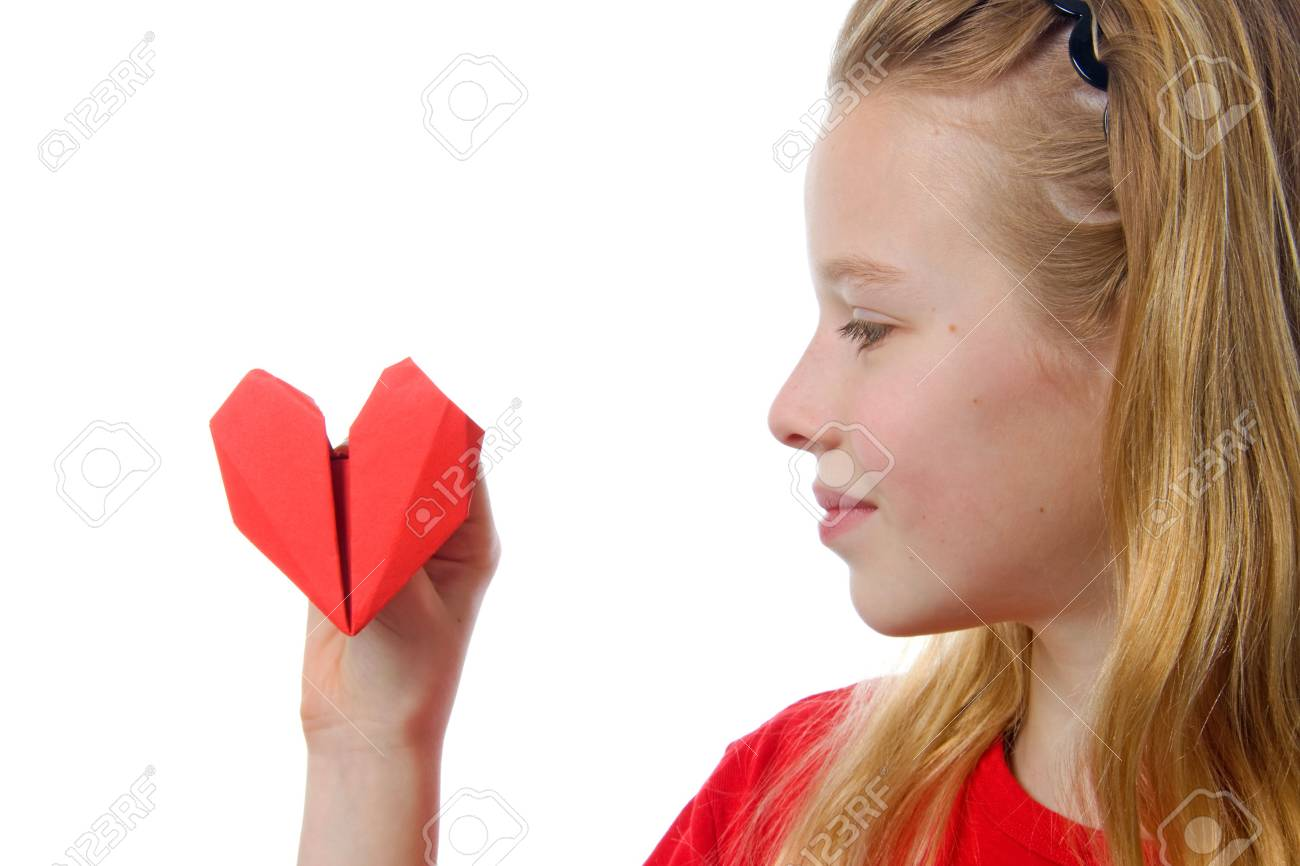 Young blonde girl with red heart made out of paper over white background Stock Photo - 6607389