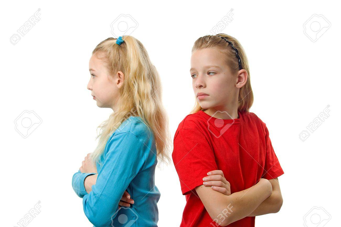 Two young girls are not speaking to each other over white background Stock Photo - 6607391