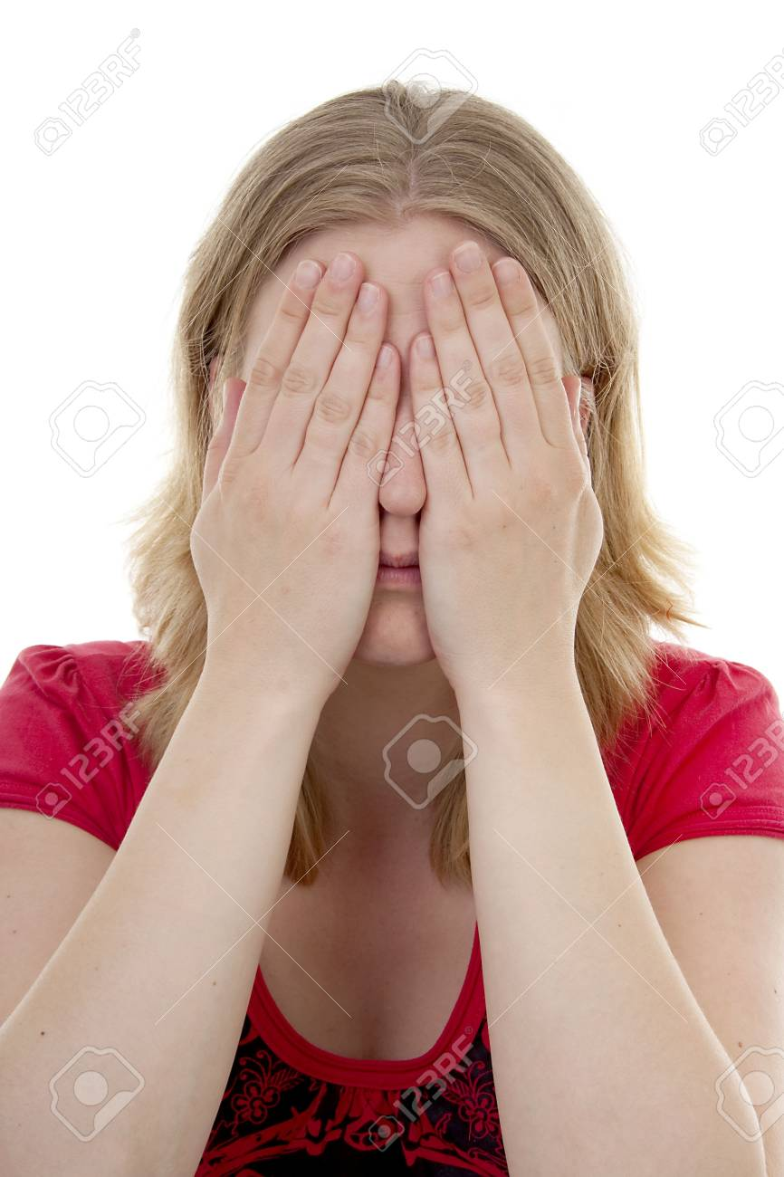 Young blonde woman covers her eyes: see no evil, isolated on white background Stock Photo - 6839594