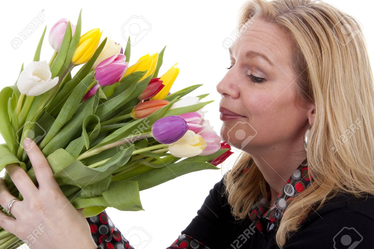 Woman with Dutch tulip flowers over white background Stock Photo - 6996418