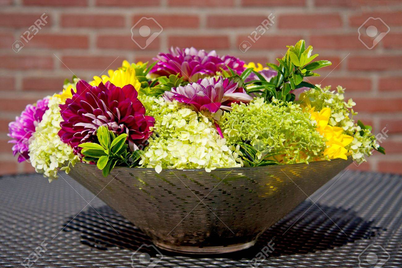 Bowl with dahlia flower arrangement on table outside stock photo bowl with dahlia flower arrangement on table outside stock photo 7336711 izmirmasajfo