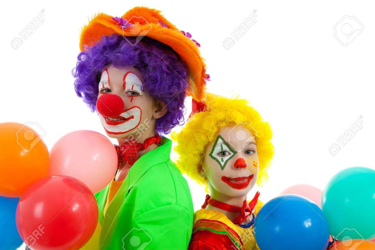 portrait of two children dressed as colorful funny clowns with balloons over white background Stock Photo - 8954127
