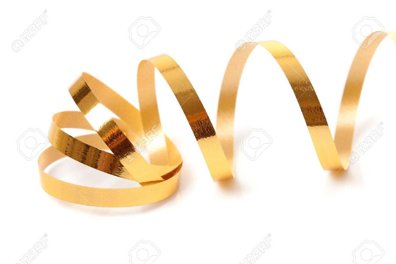 Golden streamer over white background Stock Photo - 9092374