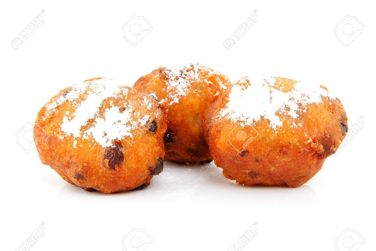 Three Dutch donut also known as oliebollen, traditional New Year's eve food isolated on white background Stock Photo - 11040490