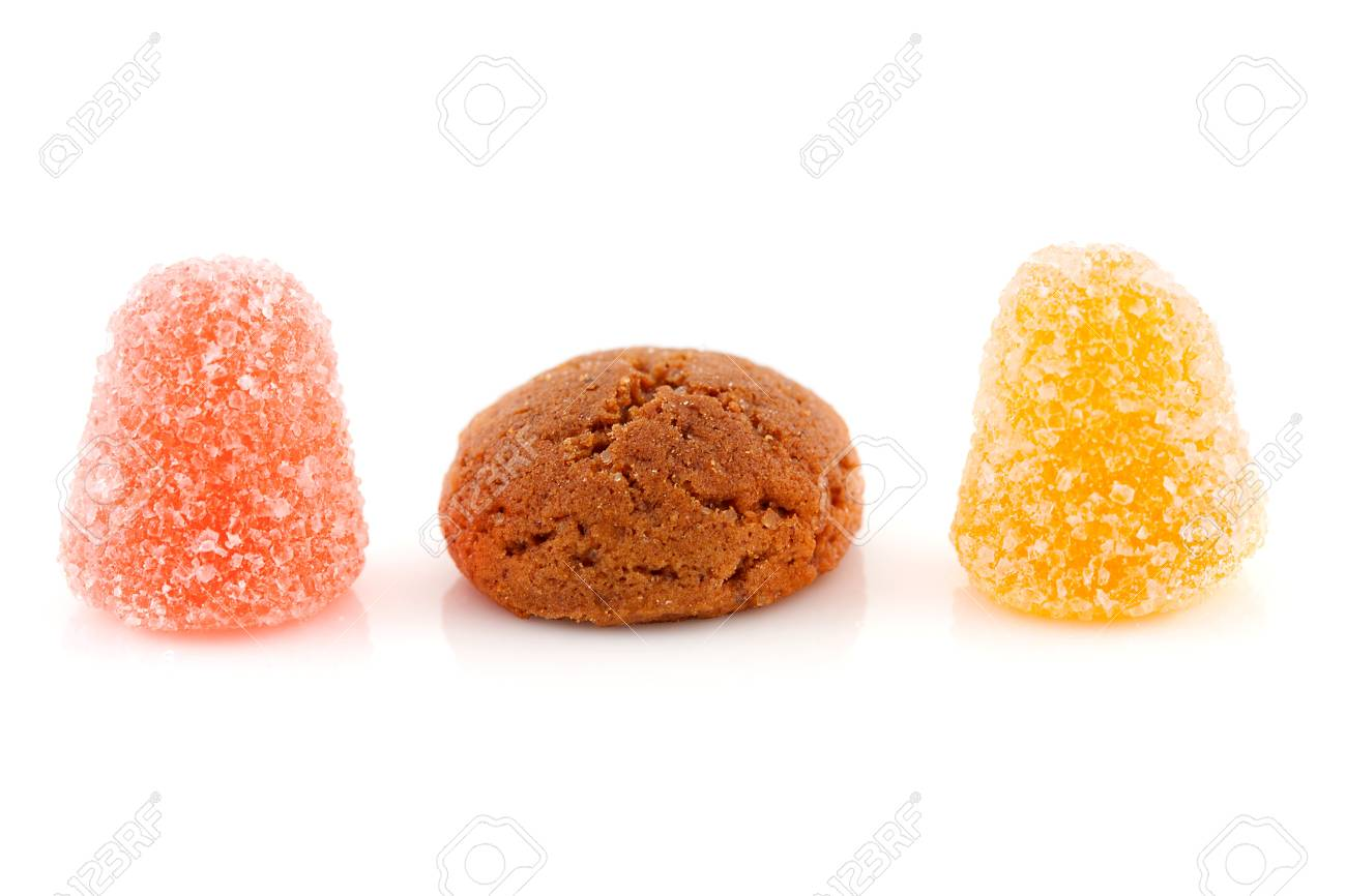 Couple of pepernoten (ginger nuts) and tumtum sweets for typical Dutch festivity at 5 december over white background Stock Photo - 11554776