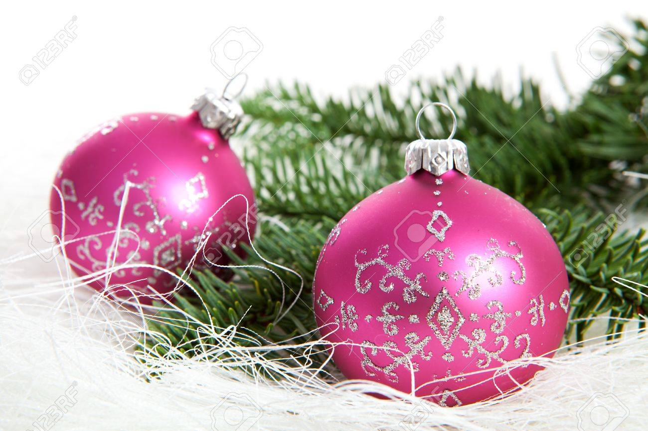 Two pink christmas balls with silver glitters over white background Stock Photo - 11554493