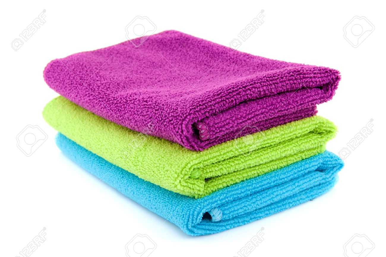 stacked colorful folded towels over white background Stock Photo - 11554518