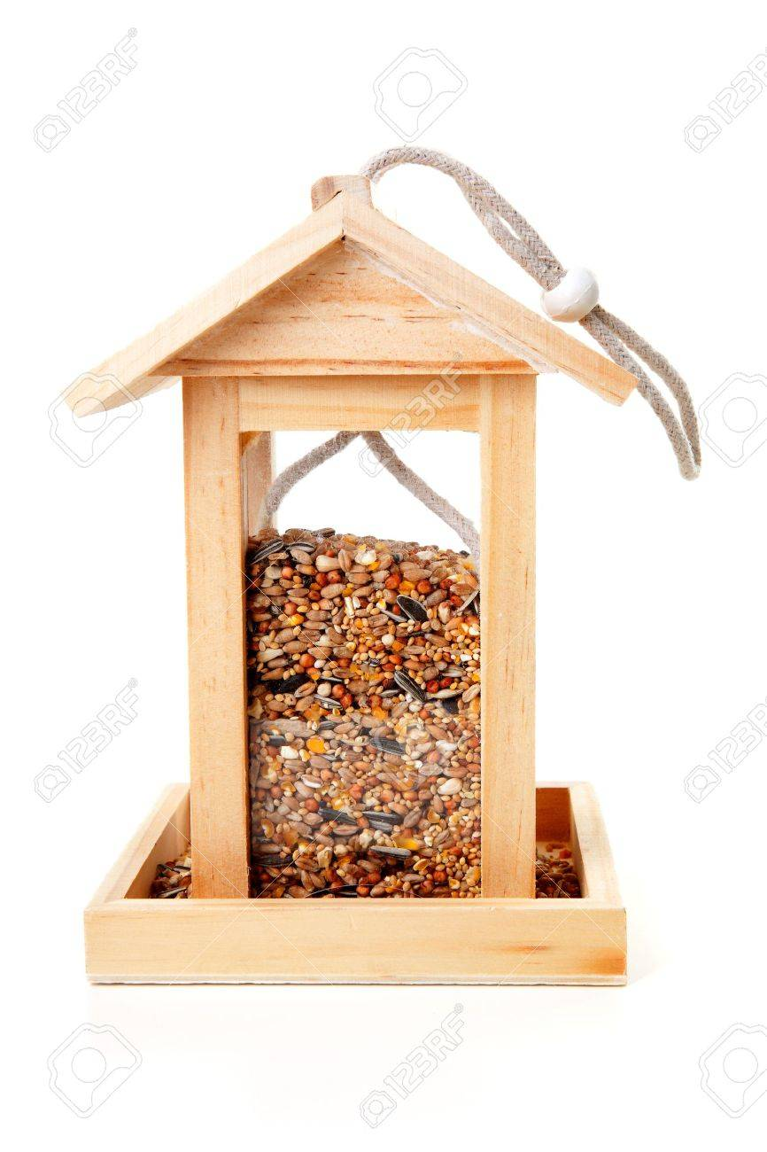 wooden bird feeder house with food over white background Stock Photo - 12790962