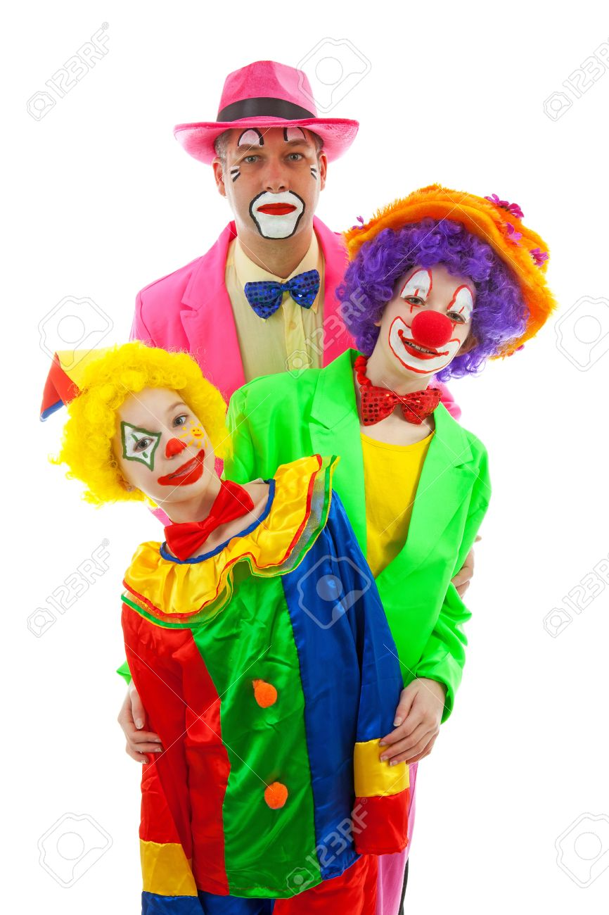 Three people dressed up as colorful funny clowns over white background Stock Photo - 12793825