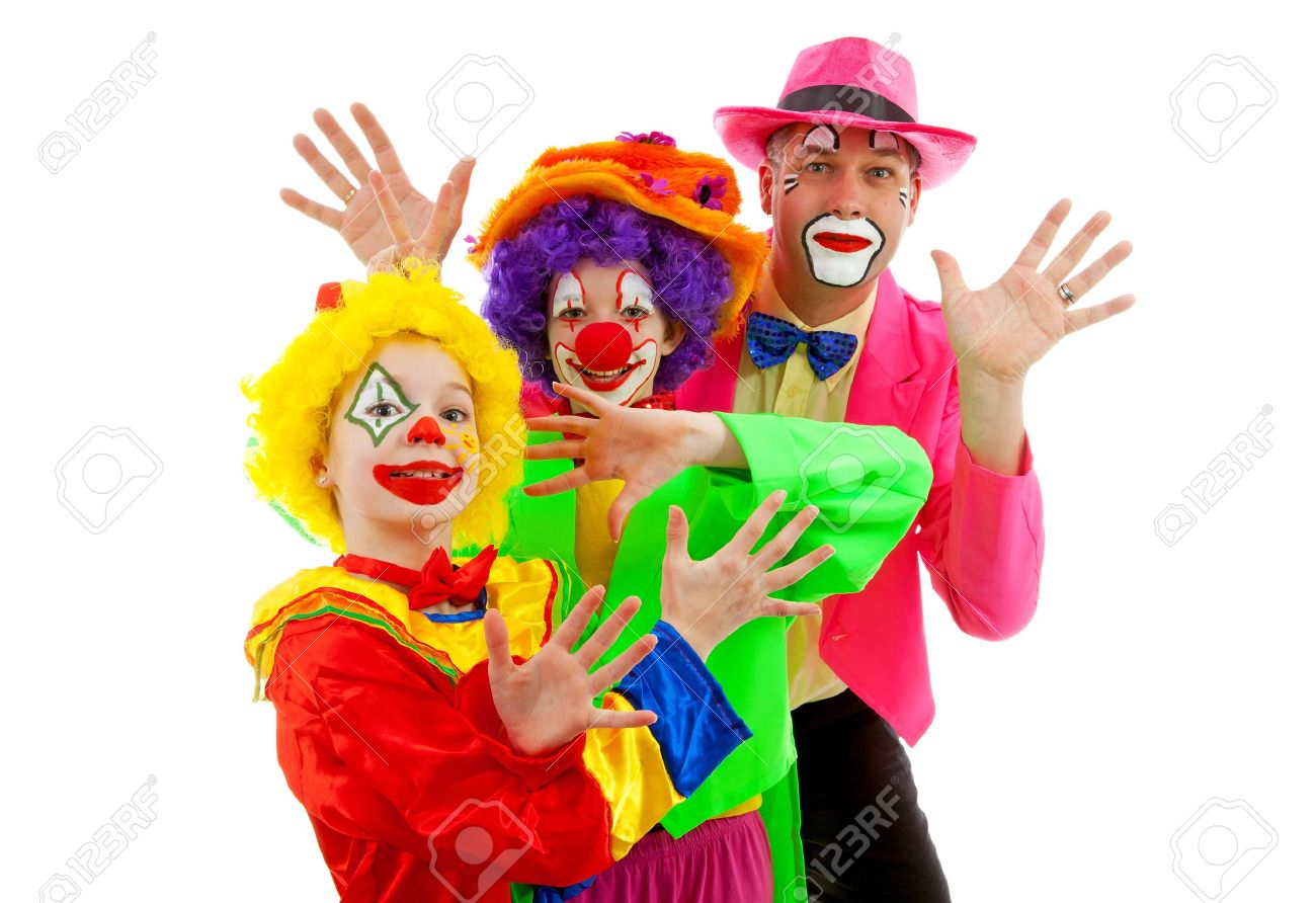 Three people dressed up as colorful funny clowns over white background Stock Photo - 12793800