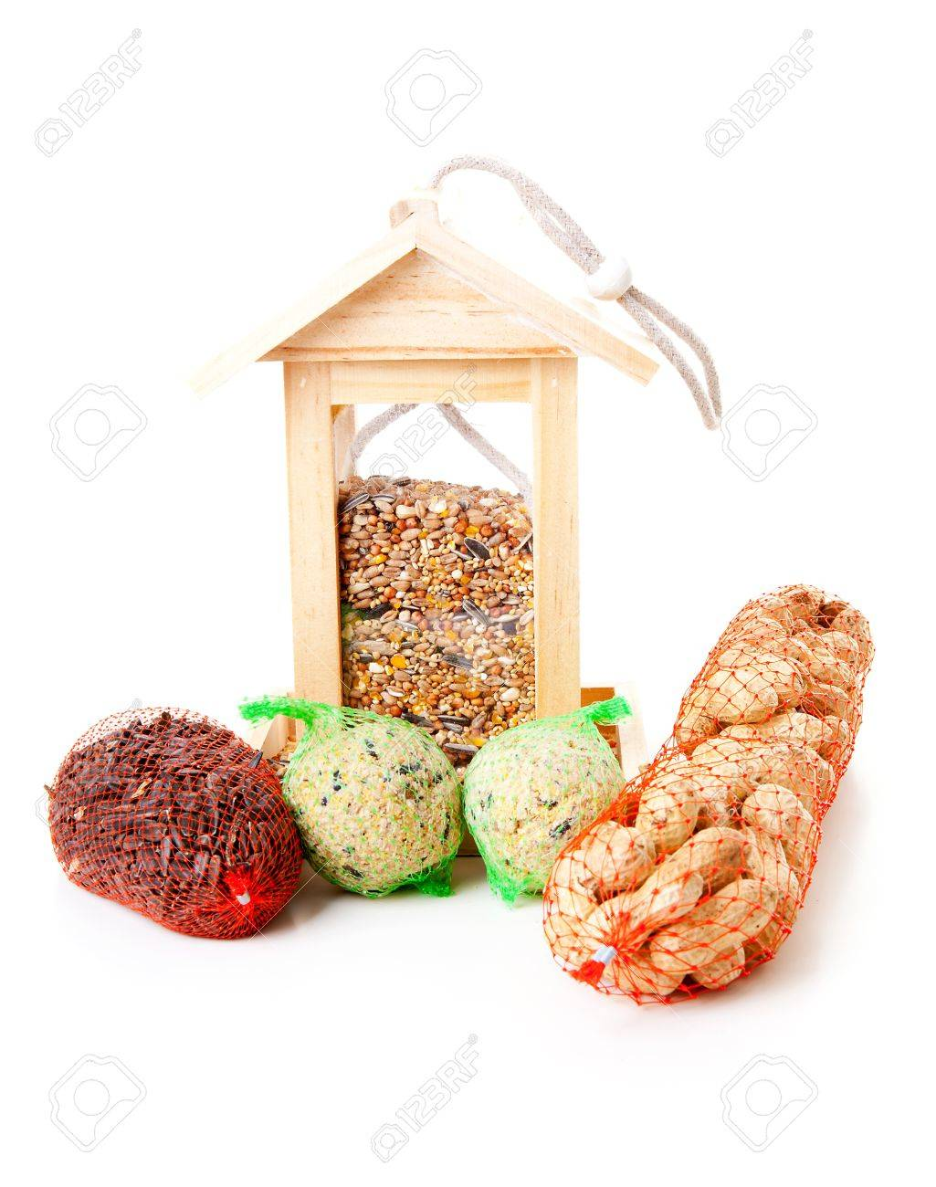 wooden bird feeder house with food over white background Stock Photo - 12793735