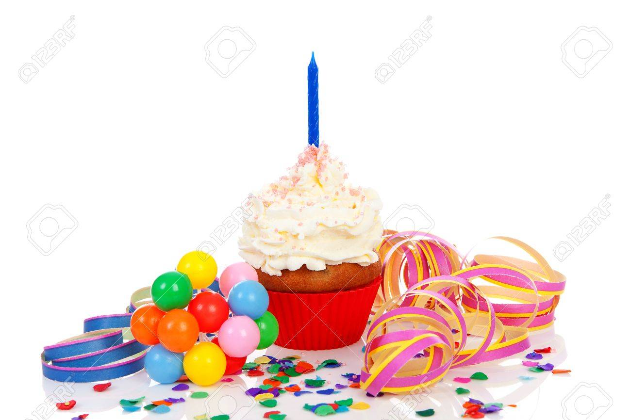 Birthday cupcake with whipped cream, party streamers and colorful confetti over white background Stock Photo - 14198770