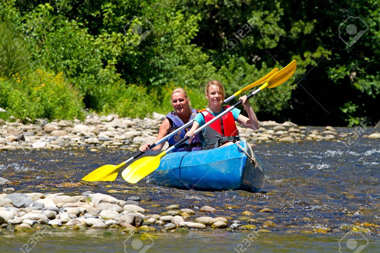 Two people in canoe enjoying holidays and nice weather in the Ardeche Stock Photo - 15037567