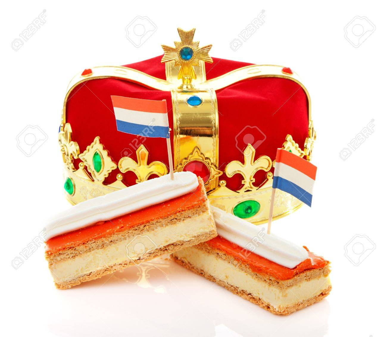 Typical Dutch tompouce sweet with crown over white background Stock Photo - 18429025