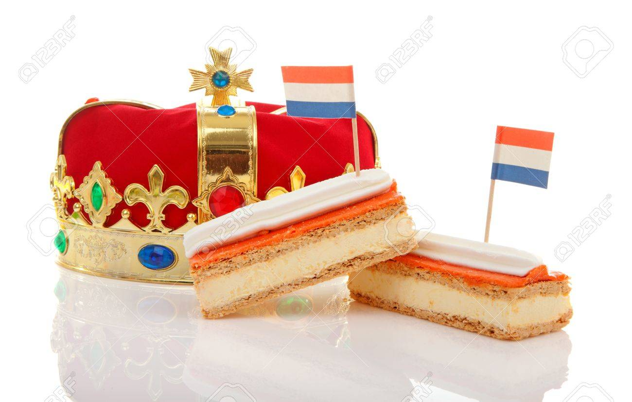 Typical Dutch tompouce sweet with crown over white background Stock Photo - 18429027