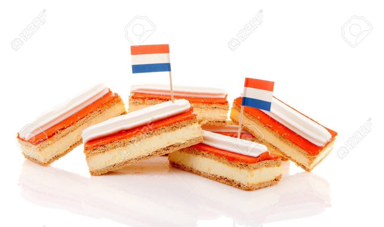 Pile of traditional Dutch pastry called tompouce with flags over white background Stock Photo - 20008567