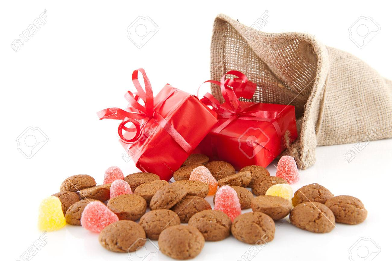 Typical Dutch celebration: Sinterklaas with surprises in bag and ginger nuts, ready for the kids in december. Isolated on white background Stock Photo - 23213855