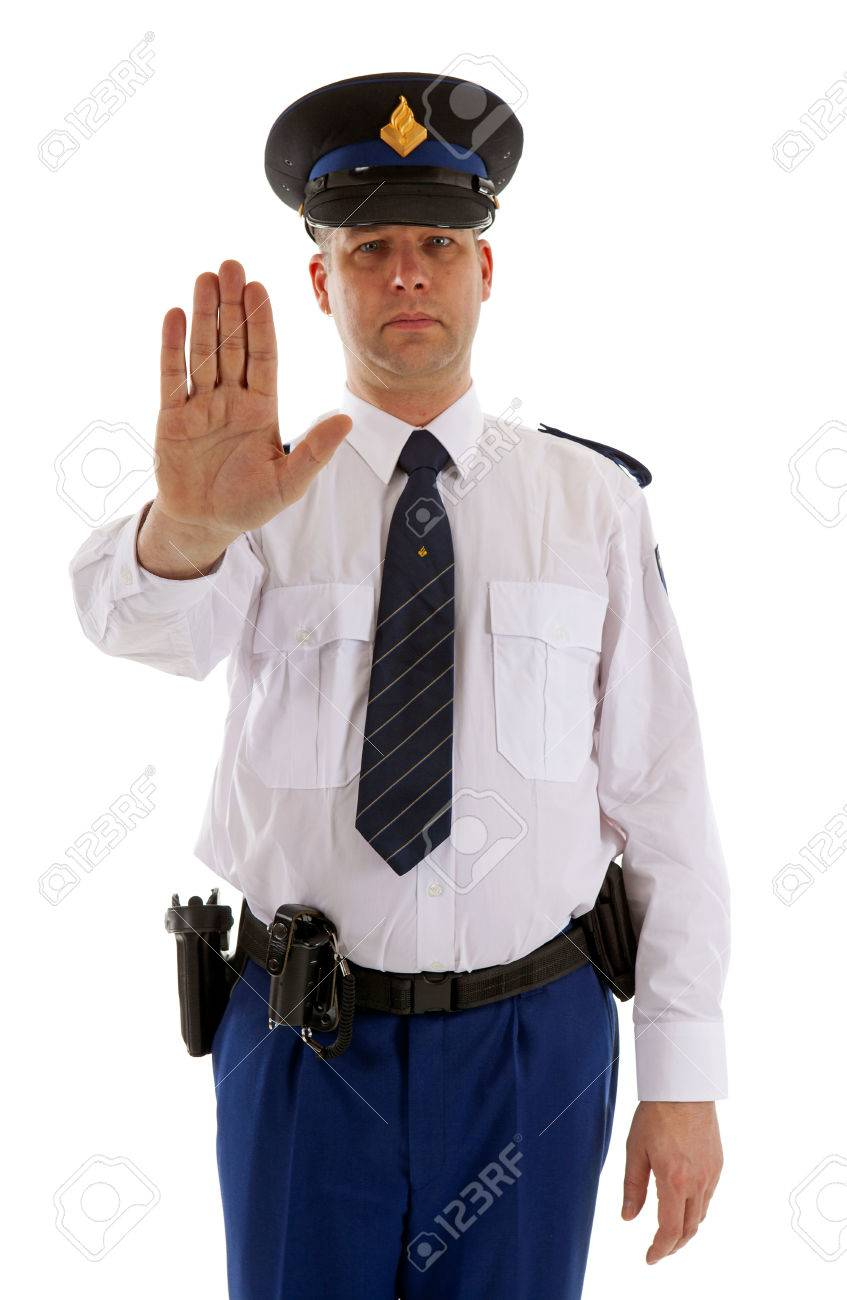 Dutch police officer is making stop sign with hand over white background Stock Photo - 24350889